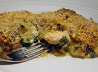 Cod and Salmon Served in a White Wine and Tarragon Sauce and Topped with Cheesy Breadcrumbs